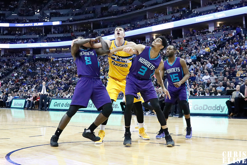 04 March 2017: Denver Nuggets forward Nikola Jokic (15) vies for the rebound with Charlotte Hornets forward Johnny O'Bryant III (8) and Charlotte Hornets guard Jeremy Lamb (3) during the Charlotte Hornets 112-102 victory over the Denver Nuggets, at the Pepsi Center, Denver, Colorado, USA.