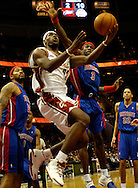 PHOTO BY DAVID RICHARD.LeBron James slips past Rasheed Wallace, left, and Ben Wallace last night in the first half.