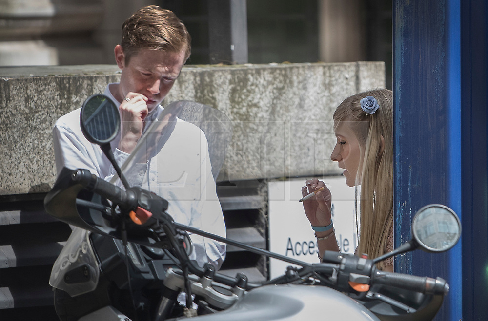 © Licensed to London News Pictures. 13/07/2017. London, UK. Connie Yates (R) talks with an advisor outside Court after leaving the court during proceedings. The parents of terminally ill Charlie Gard have returned to the High Court in light of new evidence relating to potential treatment for their son's condition. An earlier lengthy legal battle ruled that Charlie could not be taken to the US for experimental treatment. London, UK. Photo credit: Peter Macdiarmid/LNP