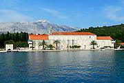 Franciscan monastery and church viewed from the sea, island of Badija, Croatia