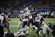 New England Patriots quarterback Tom Brady (12) throws a pass while pressured by Philadelphia Eagles defensive tackle Fletcher Cox (91) during the 2018 NFL Super Bowl LII football game against the Philadelphia Eagles on Sunday, Feb. 4, 2018 in Minneapolis. The Eagles won the game 41-33. (©Paul Anthony Spinelli)