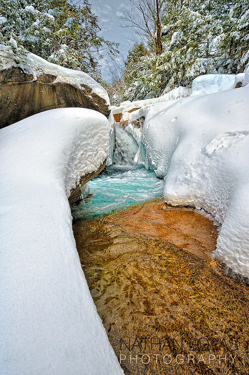 Snow along the Pemi River;  The Basin, Franconia Notch, New Hampshire.
