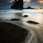 The seastacks along Second Beach are silhouetted at sunset in Olympic National Park, Washington.