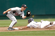 Tyler Henley of Rice (R) slides into second base with a stolen base, before Georgia second basemen Matthew Dunn (L) can make the tage in the third inning.  The Rice Owls defeated the Georgia Bulldogs 6-4 during second day action at the College World Series at Rosenblatt Stadium in Omaha, Nebraska, June 17, 2006.