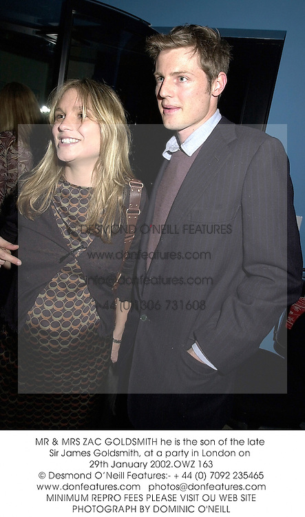 MR & MRS ZAC GOLDSMITH he is the son of the late Sir James Goldsmith, at a party in London on 29th January 2002.	OWZ 163