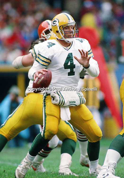 Green Bay Packers quarterback Brett Favre (4) looks to pass during the NFL football game against the Cleveland Browns on Oct. 18, 1992 in Cleveland. The Browns won the game 17-6. (©Paul Anthony Spinelli)