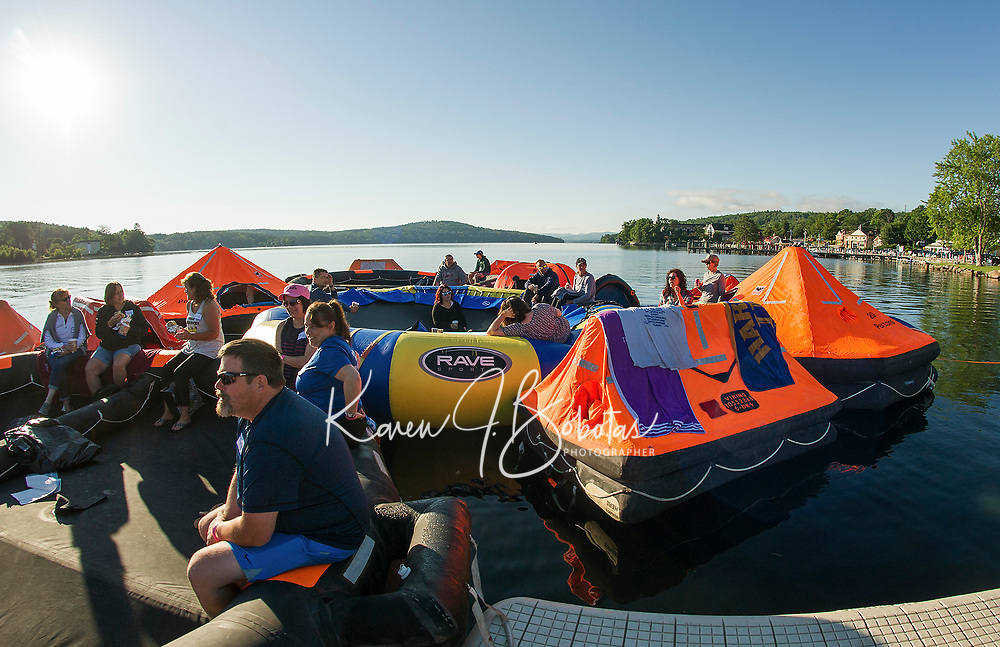 """The overnight crew awakes to a the calm Saturday morning on Meredith Bay during the Make A Wish """"Rafting for Wishes"""" event at Hesky Park on Saturday.  (Karen Bobotas/for the Laconia Daily Sun)"""