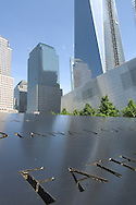 Engravings of the names of the fallen echo the design of the reflecting pools.