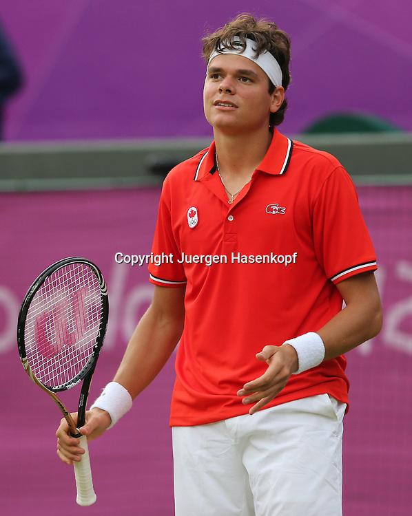 Olympiade,Wimbledon,AELTC,London 2012.Olympic Tennis Tournament, Milos Raonic (CAN) schaut enttaeuscht,.frustriert,Einzelbild,Halbkoerper,Hochformat,