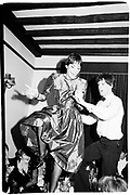 Nicky Shulam dancing on the table, Keats dinner, Oxford. 1980. SUPPLIED FOR ONE-TIME USE ONLY> DO NOT ARCHIVE. © Copyright Photograph by Dafydd Jones 66 Stockwell Park Rd. London SW9 0DA Tel 020 7733 0108 www.dafjones.com