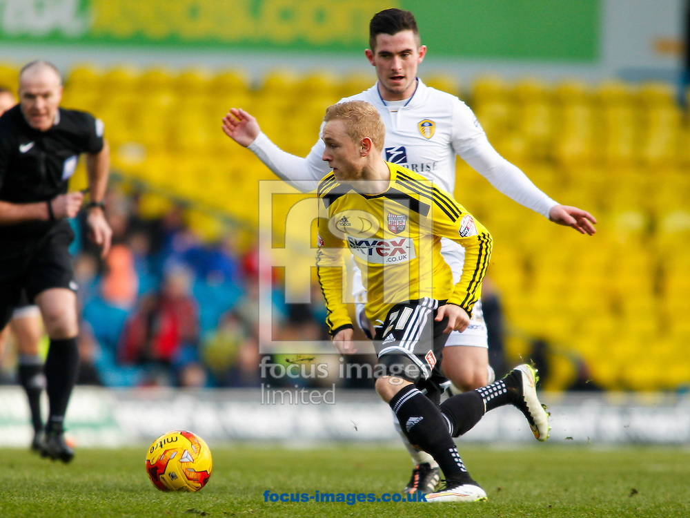 Alex Pritchard of Brentford and Lewis Cook of Leeds United during the Sky Bet Championship match between Leeds United and Brentford at Elland Road, Leeds<br /> Picture by Mark D Fuller/Focus Images Ltd +44 7774 216216<br /> 07/02/2015