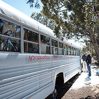 Attorney's Mel O'Reilly and Brendan O'Reilly walk around the Aggressive Christianity Missions Training Corps (ACMTC) bus on the compound in Fence Lake Feb. 27th, 2019.