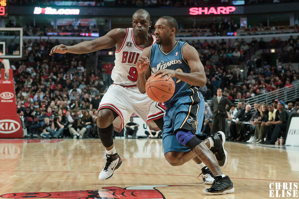 13 November 2010: Washington Wizards' point guard #9 Gilbert Arenas drives past Chicago Bulls' small forward #9 Luol Deng during the Chicago Bulls 103-96 victory over the Washington Wizards at the United Center, in Chicago, Illinois, USA.