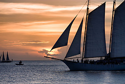 Boats passing through Key West sunset