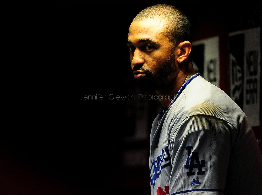 Jul. 15 2011; Phoenix, AZ, USA; Los Angeles Dodgers outfielder Matt Kemp (27) reacts in the dugout while playing against the Arizona Diamondbacks at Chase Field. The Dodgers defeated the Diamondbacks 6-4.  Mandatory Credit: Jennifer Stewart-US PRESSWIRE..