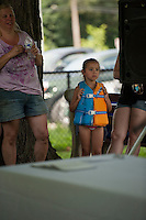 Aubrielle Gibson listens as July 29, 2014 marks the 70th anniversary celebration for the Kiwanis Pool in St. Johnsbury Vermont.  Karen Bobotas / for Kiwanis International