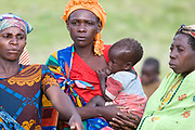 A Batwa woman nurses her child at the Rwamahano Settlement in Uganda.