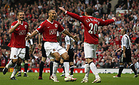 Photo: Paul Thomas.<br /> Manchester United v Newcastle United. The Barclays Premiership. 01/10/2006.<br /> <br /> Ole Gunnar Solskjaer (20) of Man Utd celebrates his second goal with team mates Rio Ferdinand (C) and Nemanja Vidic (L).