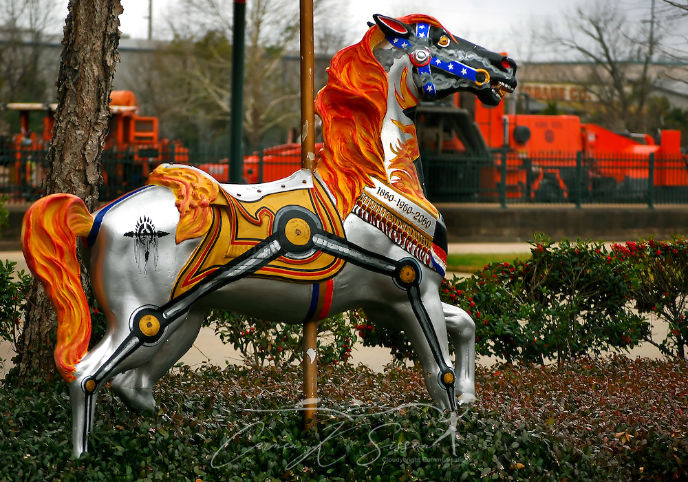 "A carousel horse sits outside Union Station in Meridian, Miss. on Jan. 9, 2011. The statue is one of 62 horses distributed throughout town as part of the ""Around Town Carousels Abound"" permanent public art exhibit, which benefits Hope Village for Children. The Union Station horse, titled ""Iron Horse,"" was designed by artist Jim Brashier and sponsored by Carousels Abound. (Photo by Carmen K. Sisson/Cloudybright)"