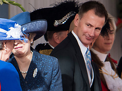 © Licensed to London News Pictures. 23/10/2018. London, UK. British Foreign secretary JEREMY HUNT looks at British Prime Minister THERESA MAY as they attend a ceremony on Horse Guards Parade in London for the arrival of King Willem-Alexander and Queen Maxima of the Netherlands as part of a state visit to the UK. Photo credit: Ben Cawthra/LNP