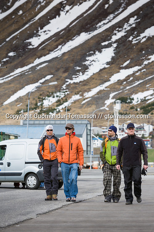 Skiers on the pier just before departure from &Iacute;safj&ouml;r&eth;ur. <br /> <br /> Images from an ski touring adventure to J&ouml;kulfir&eth;ir, a series of fjords in west Iceland, with Bergmenn Mountain Guides and Borea Adventures. The tour takes skiers from fjord to fjord with the sail boat Aurora as a overnight base.