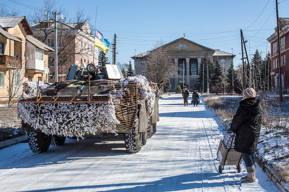 MYRONIVSKYI, UKRAINE - FEBRUARY 17: Ukrainian forces pass through the center of town on February 17, 2015 in Myronivskyi, Ukraine. A ceasefire agreed to by Ukraine and pro-Russian rebel forces has failed to prevent fighting in the nearby town of Debaltseve, where thousands of Ukrainian troops remain and whom rebels claim to have surrounded. (Photo by Brendan Hoffman/Getty Images) *** Local Caption ***