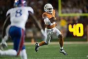 AUSTIN, TX - NOVEMBER 7:  Jerrod Heard #13 of the Texas Longhorns breaks free against the Kansas Jayhawks during the 1st quarter on November 7, 2015 at Darrell K Royal-Texas Memorial Stadium in Austin, Texas.  (Photo by Cooper Neill/Getty Images) *** Local Caption *** Jerrod Heard