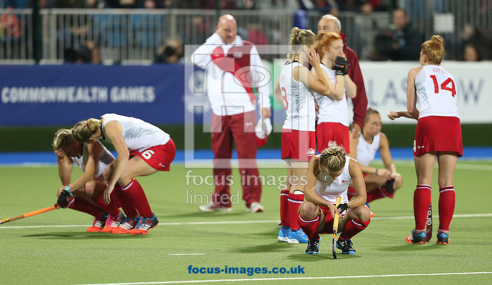 The England team look dejected after losing in the Women's Final during day ten of the Hockey at Glasgow National Hockey Centre, during the Glasgow 2014 Commonwealth Games.<br /> Picture by Paul Terry/Focus Images Ltd +44 7545 642257<br /> 02/08/2014