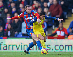 LONDON, ENGLAND - Saturday, February 21, 2015: Arsenal's Alexis Sanchez in action against Crystal Palace's Jack Hunt during the Premier League match at Selhurst Park. (Pic by David Rawcliffe/Propaganda)