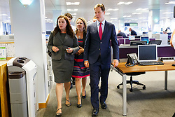 © Licensed to London News Pictures. 05/08/2014. CARDIFF, UK. (L to R) Eluned Parrott AM, Jenny Willott MP and Deputy Prime Minister Nick Clegg visiting British Gas in Cardiff to meet company's customer service apprentices and promote apprenticeships as British Gas announces 450 new work placements nationally on Tuesday, 05 August 2014. Photo credit : Tolga Akmen/LNP