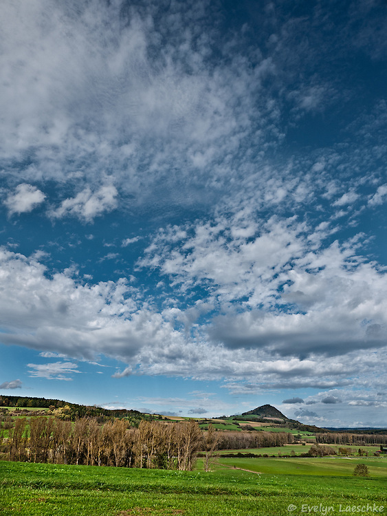 The Hegau landscape with its volcanic cone mountains - A storm is approaching.
