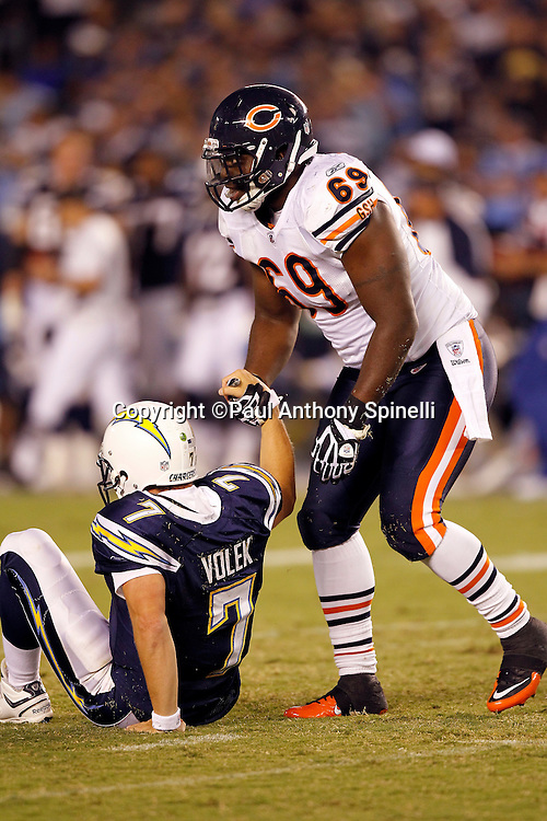 Chicago Bears defensive end Henry Melton (69) helps San Diego Chargers quarterback Billy Volek (7) up during a NFL week 1 preseason football game against the San Diego Chargers, Saturday, August 14, 2010 in San Diego, California. The Chargers won the game 25-10. (©Paul Anthony Spinelli)