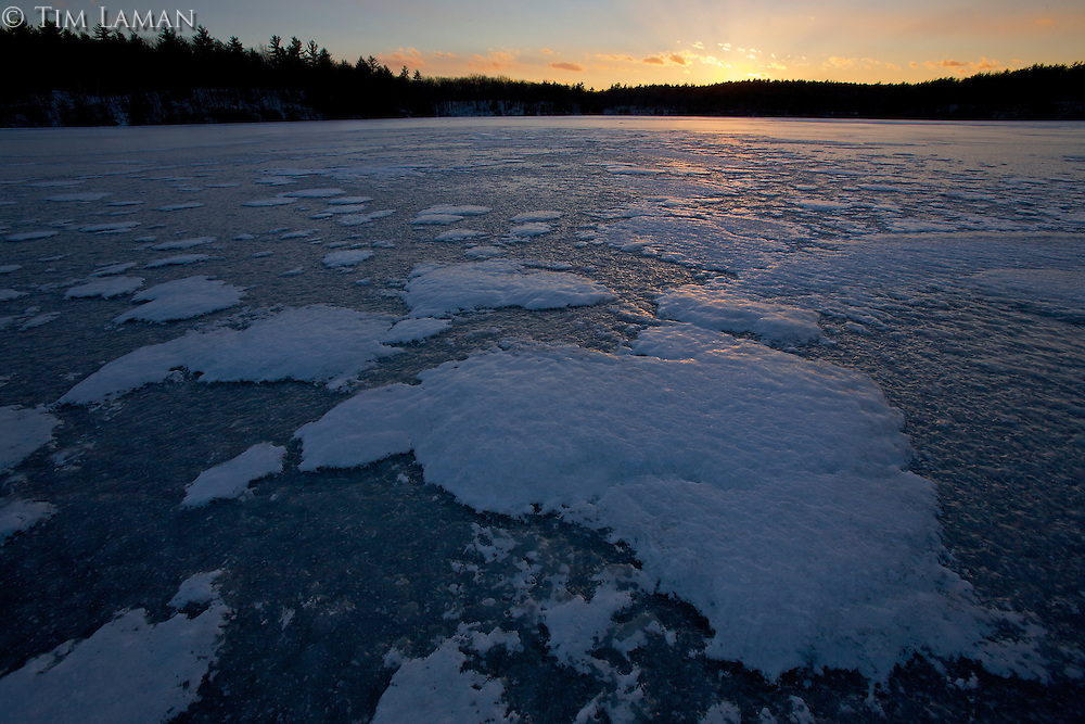 A frozen Walden Pond at sunrise.