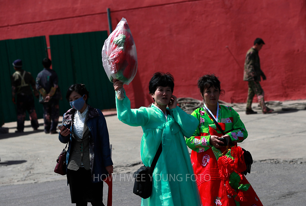A North Korean woman holds up a bag of material for 'Day of the Sun Festival' celebration in Pyongyang, North Korea, 12 April 2017. North Koreans prepare to celebrate the 'Day of the Sun Festival', 105th birthday anniversary of former North Korean supreme leader Kim Il-sung in Pyongyang on 15 April.