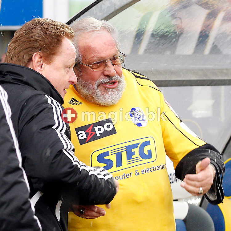 Former FC Luzern player Paul WOLFISBERG (R), who played his first match 60 years ago, talks to head coach Rolf Fringer prior to the AXPO Super League (National League A) soccer match between FC Luzern (FCL) and FC Basel (FCB) at the Gersag stadium in Emmenbruecke, Switzerland, Sunday, February 27, 2011. (Photo by Patrick B. Kraemer / MAGICPBK)
