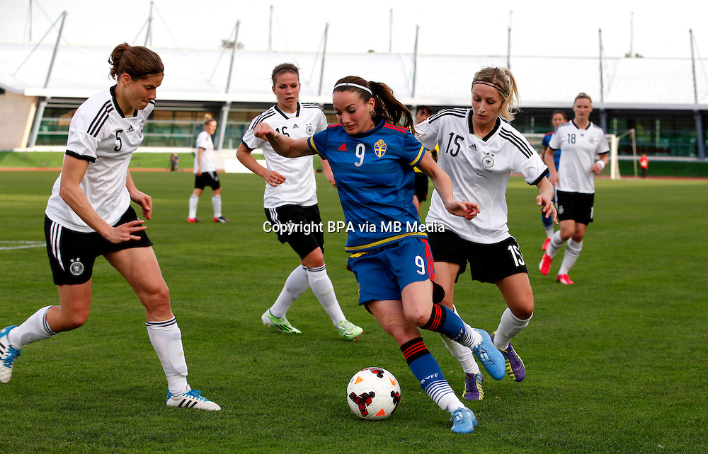 Fifa Womans World Cup Canada 2015 - Preview //<br /> Algarve Cup 2015 Tournament ( Vila Real San Antonio Sport Complex - Portugal ) - <br /> Germany vs Sweden 2-4   -  Kosovare Asllani of Sweden (Middle) , challenges with Annike Krahn (L) and Kathrin Hendrich of Germany (R)