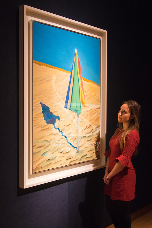 Christies, St James, London, February 5th 2016. A woman studies David Hockney's Beach Umbrella which is expected to fetch between £1-1.5 million at auction, during the 20th Century Art Sale Preview. ///FOR LICENCING CONTACT: paul@pauldaveycreative.co.uk TEL:+44 (0) 7966 016 296 or +44 (0) 20 8969 6875. ©2015 Paul R Davey. All rights reserved.