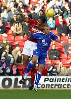 Photo: Dave Linney.<br />Walsall v Gillingham. Coca Cola League 1. 12/11/2005. Chris Westwood(Walsall) outjumps Danny Jackman(Gillingham)