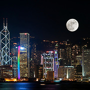CHINA (Hong Kong). 2009. Moon over Hong Kong´s skyline.