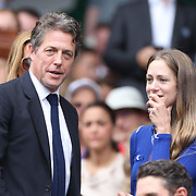 LONDON, ENGLAND - JULY 16: Hannah Bagshawe and Hugh Grant at the Mens Singles Final between Roger Federer of Switzerland and Marin Cilic of Croatia during the Wimbledon Lawn Tennis Championships at the All England Lawn Tennis and Croquet Club at Wimbledon on July 16, 2017 in London, England. (Photo by Tim Clayton/Corbis via Getty Images)