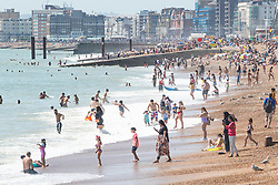 © Licensed to London News Pictures. 23/06/2020. Brighton, UK. Members of the public take advantage of the sunny and warm weather and head to the beach in Brighton and Hove. Photo credit: Hugo Michiels/LNP