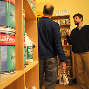 "4/5/11 -- BRUNSWICK, Maine.  Fred Horch, right, discusses paints which are less harmful to the air with a customer on Tuesday afternoon. Horch, the owner of the shop which bears his name on Maine St. in Brunswick, has decided to sell the environmentally friendly products store while he and his family travel to Japan for a year. Horch's wife, Hadley, is a professor at Bowdoin and will be on sabbatical. ""I'll miss the people more than anything here the store "" said Horch. He hopes to turn over the store to a new owner by June 1 and will be moving in July. Photo by Roger S. Duncan."