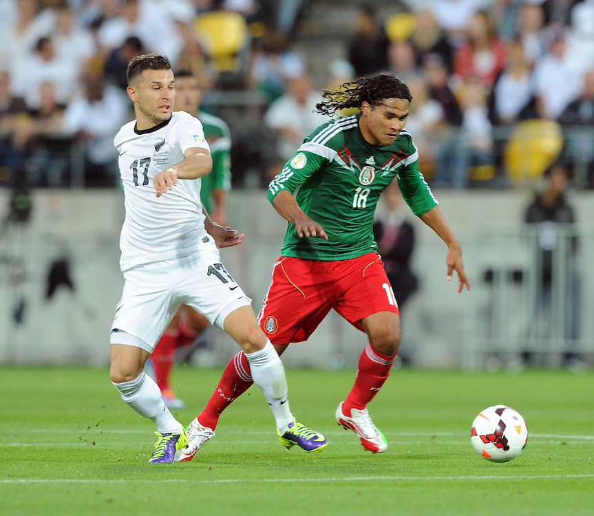 New Zealand's Kosta Barbarouses, left and Mexico's Carlos Pena in the World Cup Football qualifier, Westpac Stadium, Wellington, New Zealand, Wednesday, November 20, 2013. Credit:SNPA / Ross Setford