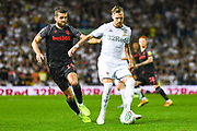 Leeds United defender Barry Douglas (3) and Stoke City defender Tommy Smith (14) during the EFL Cup match between Leeds United and Stoke City at Elland Road, Leeds, England on 27 August 2019.