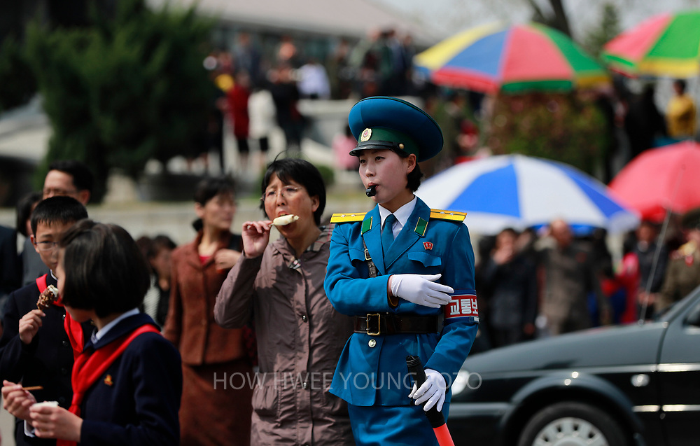 A North Korean traffic police-woman directs traffic in Pyongyang, North Korea, 16 April 2017. A North Korean missile exploded within seconds of its launch on the east coast on 16 April, South Korean and US officials say as tensions rise in the region over nuclear issues.