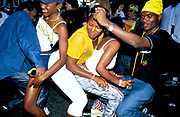Three girls and two men dancing together, Notting Hill Carnival, UK, 2000's