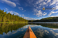 Kayaking on Beaver Lake in the Stillwater State Forest near Whitefish, Montana, USA