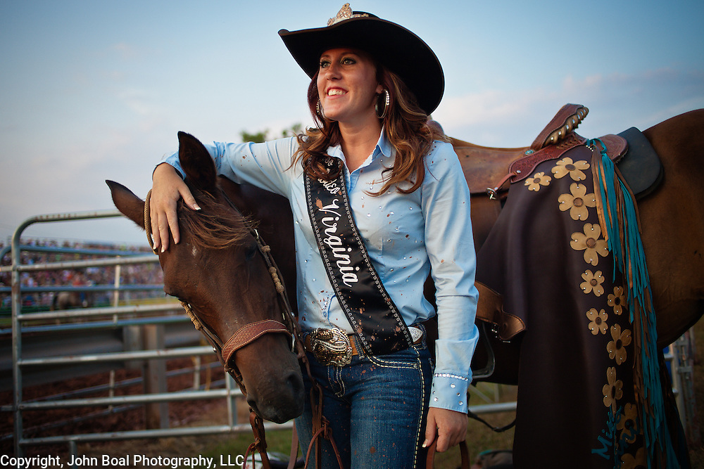 "Melissa McMullan, Miss Rodeo Virginia 2014, of Ft. Valley, VA, stands with her horse, Sarah, during the Dave Martin Rodeo, at the Prince William County Fair, in Manassas, VA, on Sunday, August 10, 2014.  McMullan represents Virginia regionally and nationally, while promoting ""rodeos and the western lifestyle"" in Virginia."