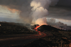Handout photo of Fountains from the fissure 8 spatter cone continue to supply lava to an open channel. The spatter cone is now about 55 m (180 ft) tall at its highest point. As observed during this morning's helicopter overflight, the fountains rarely rise above the rim of the spatter cone. Kilauea Volcano, HI, USA, June 30, 2018. Photo by USGS via ABACAPRESS.COM