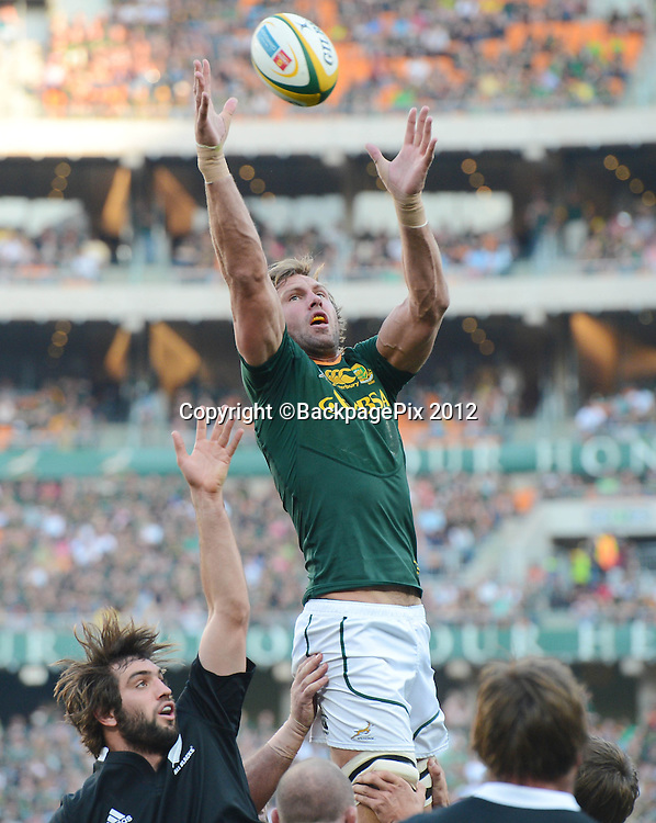 Andries Bekker of South Africa  and Samuel Whitelock of New Zealand during the 2012 Castle Rugby Championship match between South Africa and New Zealand played at Soccer City in Johannesburg, South Africa on 6 October 2012 © Barry Aldworth/BackpagePix